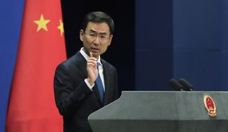 """Chinese Foreign Ministry spokesman Geng Shuang gestures as he speaks during a daily briefing at the Ministry of Foreign Affairs office in Beijing, Monday, Sept. 4, 2017. China said U.S. President Donald Trump's threat to cut off trade with countries that deal with North Korea is unacceptable and unfair. Trump said on Twitter on Sunday the United States is considering halting trade with """"any country doing business with North Korea."""" His remarks came after North Korea detonated a thermonuclear device in its sixth and most powerful nuclear test. (AP Photo/Andy Wong)"""