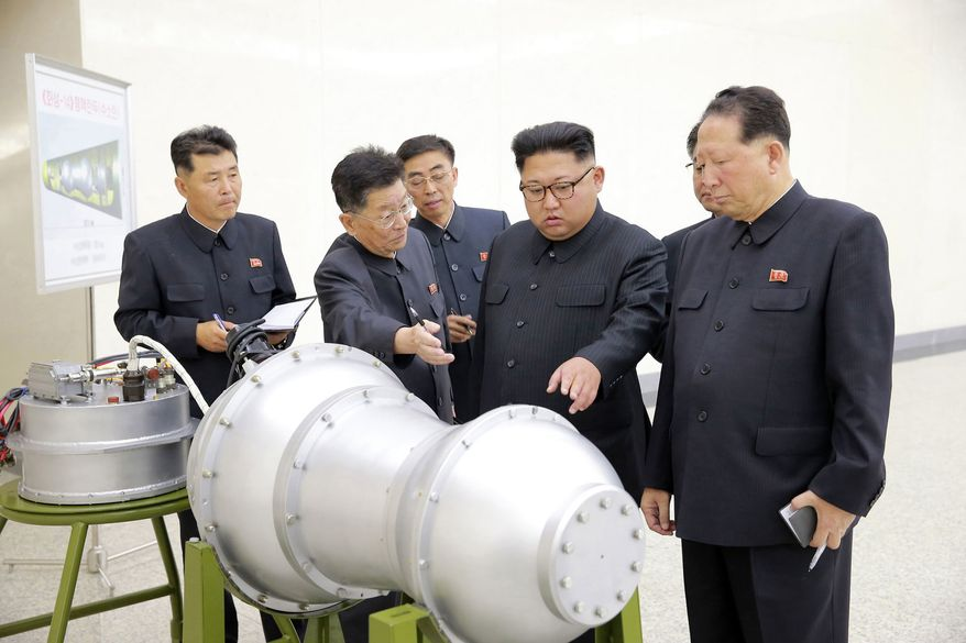 This undated file photo distributed on Sunday, Sept. 3, 2017, by the North Korean government, shows North Korean leader Kim Jong-un, second from right, at an undisclosed location in North Korea. (Korean Central News Agency/Korea News Service via AP, File)