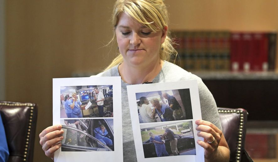 In this Friday, Sept. 1, 2017, photo, nurse Alex Wubbels displays video frame grabs from SaltLake City Police Department body cams of herself being taken into custody, during an interview, in Salt Lake City. Officials at University of Utah Hospital where Wubbels was arrested after refusing to allow police to draw a patient's blood are apologizing that security officers didn't intervene and saying they've implemented policy changes. (AP Photo/Rick Bowmer)