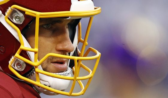 FILE - In this Aug. 10, 2017, file photo, Washington Redskins quarterback Kirk Cousins waits for a preseason NFL football game against the Baltimore Ravens in Baltimore. All I have to do, all anybody with a one-year deal has to do, is focus on winning football games, said Cousins, who threw for 25 touchdowns and a franchise-record 4,917 yards last season. If you do that, there is going to be plenty of opportunities down the road. (AP Photo/Patrick Semansk, File)