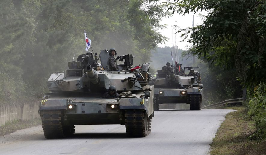"""South Korean army's K-1  tanks move during a military exercise in Paju, South Korea, near the border with North Korea, Monday, Sept. 4, 2017. Following U.S. warnings to North Korea of a """"massive military response,"""" South Korea's military on Monday fired missiles into the sea to simulate an attack on the North's main nuclear test site a day after Pyongyang detonated its largest ever nuclear test explosion. (AP Photo/Ahn Young-joon)"""