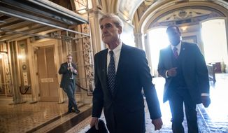 In this June 21, 2017, file photo, special counsel Robert Mueller departs after a closed-door meeting with members of the Senate Judiciary Committee about Russian meddling in the election and possible connection to the Trump campaign, at the Capitol in Washington. As Congress returns to Washington, a web of President Donald Trump's family and associates will be in the crosshairs of committees investigating whether his campaign colluded with Russia last year, as well as of the high-wattage legal team assembled by Mueller. (AP Photo/J. Scott Applewhite, File)
