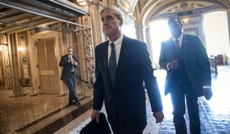 In this June 21, 2017, file photo, special counsel Robert Mueller departs after a closed-door meeting with members of the Senate Judiciary Committee about Russian meddling in the election and possible connection to the Trump campaign, at the Capitol in Washington. (AP Photo/J. Scott Applewhite, File)
