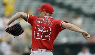 Los Angeles Angels pitcher Parker Bridwell works against the Oakland Athletics in the first inning of a baseball game, Monday, Sept. 4, 2017, in Oakland, Calif. (AP Photo/Ben Margot)