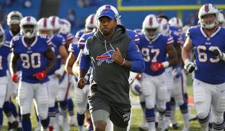 FILE - In this Thursday, Aug. 31, 2017, file photo, Buffalo Bills quarterback Tyrod Taylor leads his team on the field before a preseason NFL football game against the Detroit Lions in Orchard Park, N.Y. The Bills play their first regular season game Sunday, Sept. 10 against the New York Jets. (AP Photo/Jeffrey T. Barnes, File)