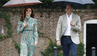 FILE - In this Wednesday, Aug. 30, 2017 file photo Britain's Prince William and his wife Kate, Duchess of Cambridge smile as they arrive at the memorial garden in Kensington Palace, London. Kensington Palace says Prince William and his wife, the Duchess of Cambridge, are expecting their third child. The announcement released in a statement Monday Sept. 4, 2017 says the queen is delighted by the news. (AP Photo/Kirsty Wigglesworth, File)
