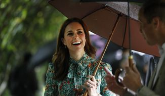 FILE - In this Wednesday, Aug. 30, 2017 file photo Britain's Prince William and his wife Kate, Duchess of Cambridge smile as they walk through the memorial garden in Kensington Palace, London. Kensington Palace says Prince William and his wife, the Duchess of Cambridge, are expecting their third child. The announcement released in a statement Monday Sept. 4, 2017 says the queen is delighted by the news. (AP Photo/Kirsty Wigglesworth, File)