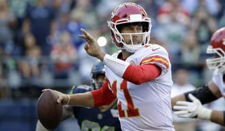 FILE - In this Aug. 25, 2017, file photo, Kansas City Chiefs quarterback Alex Smith prepares to throw against the Seattle Seahawks in the first half of an NFL football preseason game in Seattle. The Chiefs return most of their roster from a team that won 12 games and the AFC West title last season. Smith is back under center, though first-round pick Patrick Mahomes II is waiting in the wings. (AP Photo/Elaine Thompson, File)