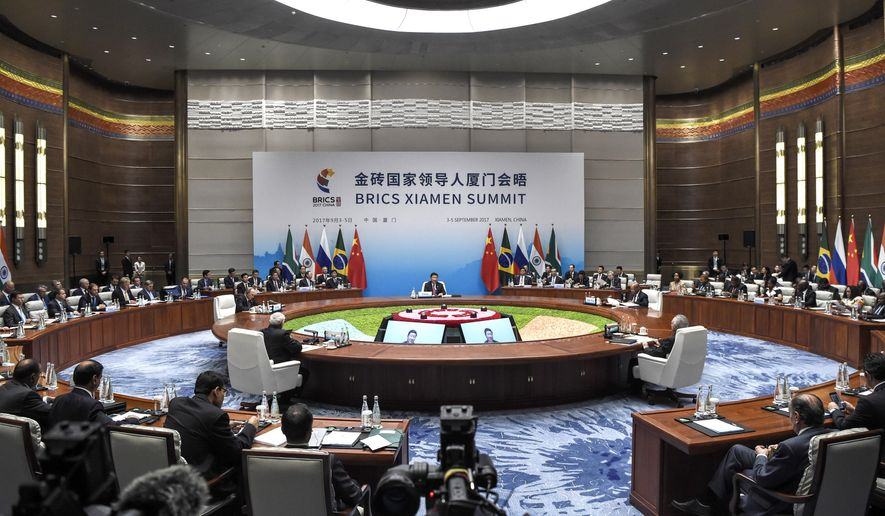 A plenary session of the BRICS Summit is held in Xiamen, Fujian province, China Monday, Sept. 4, 2017. Five major emerging economies opened a summit Monday to map out their future course, with host Chinese President Xi Jinping calling on them to play a bigger role in world governance, reject protectionism and inject new energy into tackling the gap between the world's wealthy and developing nations. (Fred Dufour/Pool Photo via AP)
