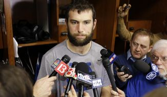 FILE - In this Jan. 2, 2017, file photo, Indianapolis Colts quarterback Andrew Luck speaks to reporters at the NFL team's practice facility in Indianapolis.  Luck will not play in Sunday's Sept. 10 season opener against the Los Angeles Rams. General manager Chris Ballard made the official announcement Monday, Sept. 4, 2017. Luck has not taken a snap or thrown a pass to a teammate since having January surgery to repair a partially torn labrum in his throwing shoulder. (AP Photo/Michael Conroy, File)