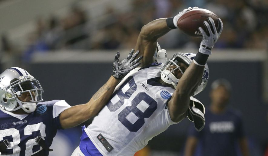In this Aug. 22, 2017, file photo, Dallas Cowboys wide receiver Dez Bryant (88) catches a pass against cornerback Orlando Scandrick (32) during NFL football practice, in Frisco, Texas. The Cowboys open their season on Sept. 10 against the New York Giants. (AP Photo/LM Otero, File)
