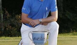 Justin Thomas poses with the trophy after winning the Dell Technologies Championship golf tournament at TPC Boston in Norton, Mass., Monday, Sept. 4, 2017. (AP Photo/Michael Dwyer)