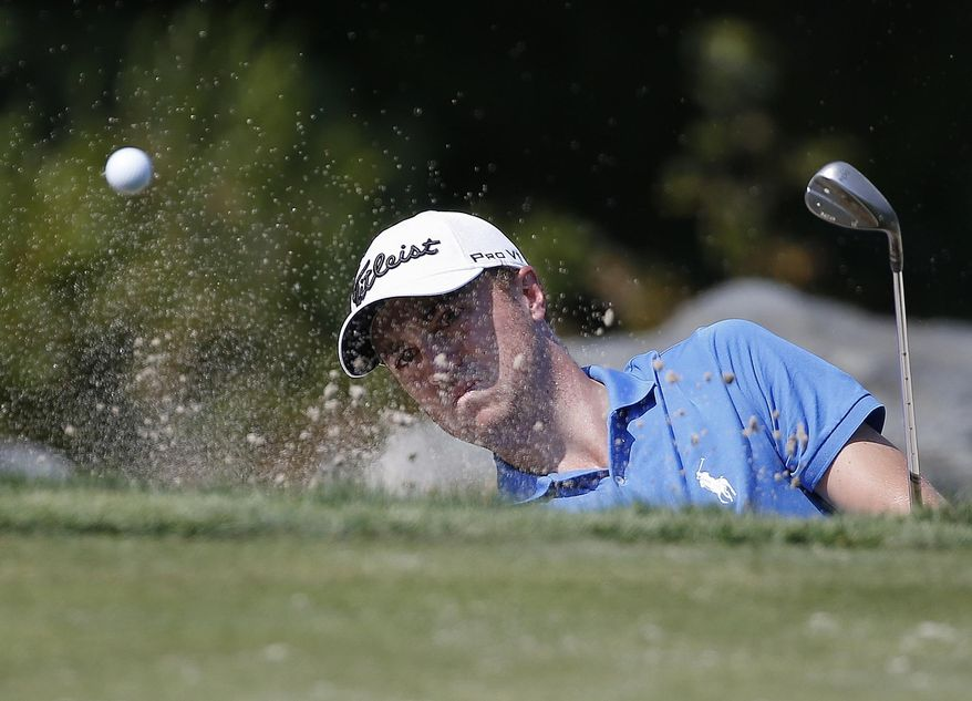 Justin Thomas hits out of a bunker on the third green during the final round of the Dell Technologies Championship golf tournament at TPC Boston in Norton, Mass., Monday, Sept. 4, 2017. (AP Photo/Michael Dwyer)