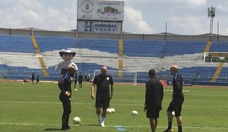 U.S. soccer goalkeepers Tim Howard, left, Nick Rimando, second from right, Brad Guzman, right, and goalkeeper coach Matt Reis, second from left, practice at Estadio Olimpico Metropolitano in San Pedro Sula, Honduras Mpnday, Sept. 4, 2017. After another stunning home loss, the United States has left itself little margin for error in its last three World Cup qualifiers, starting with Tuesday afternoon's match in the tropical heat and humidity of Honduras. (AP Photo/Ron Blum)