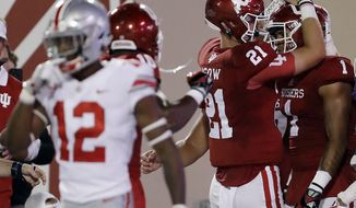 FILE - This Aug. 31, 2017 file photo shows Indiana quarterback Richard Lagow (21) celebrating an 8-yard touchdown reception by wide receiver Simmie Cobbs Jr. (1) during the first half of an NCAA college football game in Bloomington, Ind. Cobbs Jr. spent one agonizing season watching his Indiana teammates do the dirty work. Now, Cobbs and Nick Westbrook will swap roles. The junior receiver will be asked to duplicate his splashy season-opening performance after learning that Westbrook has been diagnosed with a season-ending knee injury. (AP Photo/Darron Cummings, file)