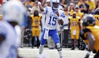 Kentucky quarterback Stephen Johnson (15) passes to a teammate while a Southern Mississippi defender closes in during the second half of an NCAA college football game against Southern Mississippi in Hattiesburg, Miss., Saturday, Sept. 2, 2017. Kentucky won 24-17. (AP Photo/Rogelio V. Solis)