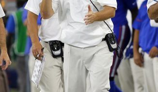 Florida head coach Jim McElwain motivates his team in the second half of an NCAA college football game against Michigan, Saturday, Sept. 2, 2017, in Arlington, Texas. (AP Photo/Tony Gutierrez)