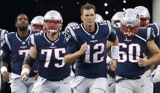 In this Aug. 10, 2017, file photo, New England Patriots quarterback Tom Brady (12) leads his team onto the field during an NFL preseason football game, in Foxborough, Mass. (AP Photo/Mary Schwalm, File)