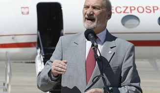 """File- In this June 21, 2017 file photo Poland's Defense Minister Antoni Macierewicz speaks during a ceremony, marking the arrival of new U.S.-made government jets in Warsaw, Poland, Macierewicz on Monday Sept. 4, 2017  accused the leaders of Germany and France of trying to """"erase"""" the tragic fate Poland suffered during World War II at German hands """"from the historical memory of Europe."""" The remark comes amid growing tensions between Poland's conservative-nationalist government and Germany, France and the European Union, whose leaders have recently criticized what they see as democratic backsliding by the Polish government. (AP Photo/Alik Keplicz,file)"""