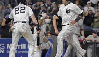 New York Yankees' Gary Sanchez, right, celebrates with Jacoby Ellsbury (22) and Brett Gardner after they all scored on a double by Starlin Castro during the sixth inning of a baseball game against the Boston Red Sox, Sunday, Sept. 3, 2017, at Yankee Stadium in New York. (AP Photo/Bill Kostroun)