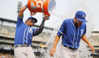 Kansas City Royals relief pitcher Scott Alexander is doused with water by Salvador Perez after defeating the Detroit Tigers 7-6 in a baseball game in Detroit, Monday, Sept. 4, 2017. (AP Photo/Paul Sancya)