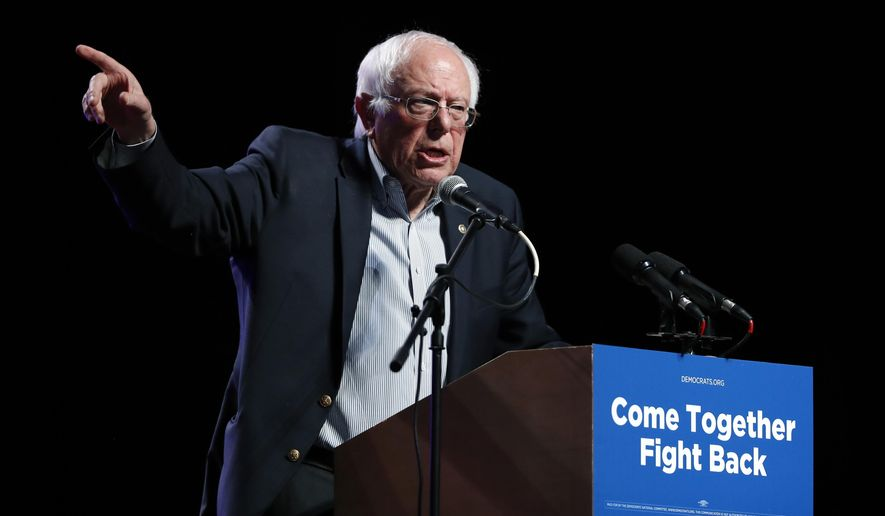 FILE- In this April 20, 2017, file photo, Sen. Bernie Sanders, I-Vt., speaks at a rally for Omaha Democratic mayoral candidate Heath Mello in Omaha, Neb. Sanders is holding rallies to focus attention on worker's rights and the minimum wage on Labor day. (AP Photo/Charlie Neibergall, File)