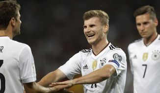Germany's Timo Werner celebrates after scoring his side's fourth goal during the World Cup Group C qualifying soccer match between Germany and Norway in Stuttgart, Germany, Monday, Sept. 4, 2017. (AP Photo/Matthias Schrader)