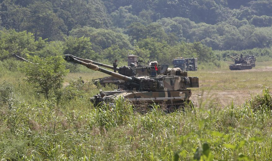 South Korean army soldiers take positions with their K-55 self-propelled howitzers during a military exercise in Paju, South Korea, near the border with North Korea, Monday, Sept. 4, 2017. North Korea said it set off a hydrogen bomb Sunday in its sixth nuclear test, which judging by the earthquake it set off appeared to be its most powerful explosion yet. (AP Photo/Ahn Young-joon)