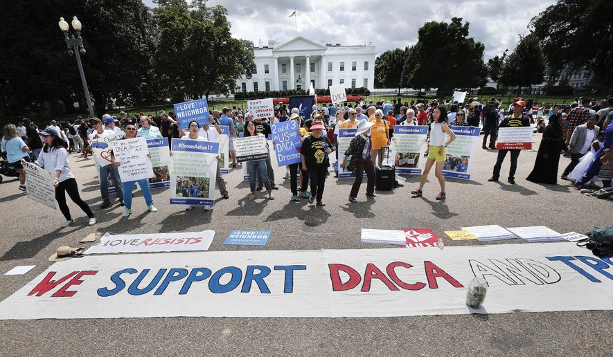 In this Sunday, Sept. 3, 2017, file photo, supporters of Deferred Action for Childhood Arrivals program (DACA), demonstrate on Pennsylvania Avenue in front of the White House in Washington. (AP Photo/Pablo Martinez Monsivais)