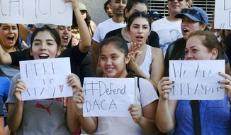 Supporters of the Deferred Action for Childhood Arrivals, or DACA, chant slogans and holds signs while joining a Labor Day rally in downtown Los Angeles on Monday, Sept. 4, 2017. President Donald Trump is expected to announce this week that he will end the Deferred Action for Childhood Arrivals, but with a six-month delay, according to two people familiar with the decision-making. (AP Photo/Richard Vogel)