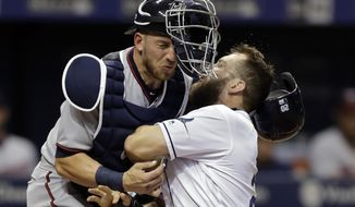 Tampa Bay Rays' Steven Souza Jr., right, crashes into Minnesota Twins catcher Mitch Garver while scoring on a sacrifice fly by Adeiny Hechavarria during the sixth inning of a baseball game, Monday, Sept. 4, 2017, in St. Petersburg, Fla. (AP Photo/Chris O'Meara)