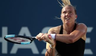 Kaia Kanepi, of Estonia, returns a shot from Darya Kasatkina, of Russia, during the fourth round of the U.S. Open tennis tournament, Monday, Sept. 4, 2017, in New York. (AP Photo/Andres Kudacki)