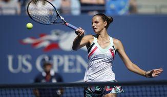 Karolina Pliskova, of the Czech Republic, returns a shot from Jennifer Brady, of the United States, during the fourth round of the U.S. Open tennis tournament, Monday, Sept. 4, 2017, in New York. (AP Photo/Jason Decrow)