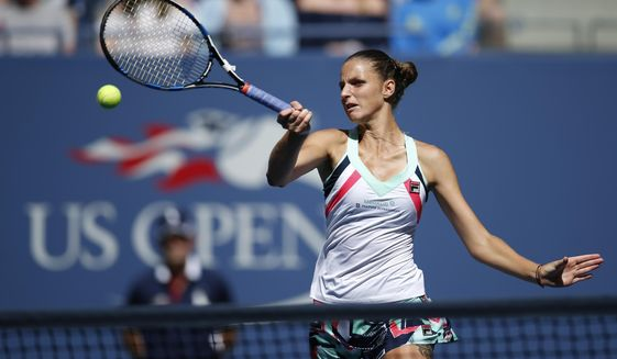 Karolina Pliskova, of the Czech Republic, returns a shot from Jennifer Brady, of the United States, during the fourth round of the U.S. Open tennis tournament, Monday, Sept. 4, 2017, in New York. (AP Photo/Jason Decrow)
