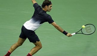 Roger Federer, of Switzerland, returns a shot against Philipp Kohlschreiber, of Germany, during the fourth round of the U.S. Open tennis tournament, Monday, Sept. 4, 2017, in New York. (AP Photo/Adam Hunger)