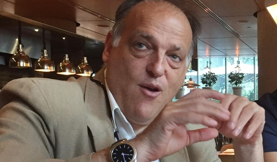 """FILE - In this file photo dated  Saturday, July 29, 2017, LaLiga president Javier Tebas speaks to reporters in Miami, USA.  Tebas said in a statement to The Associated Press on Monday Sept. 4, 2017, that Abu Dhabi-funded Manchester City and Qatari-owned PSG are benefiting from state aid which distorts European competitions and """"is irreparably harming the football industry.""""(AP Photo/Gisela Salomon, FILE)"""