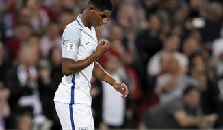 England's Marcus Rashford reacts after scoring during the World Cup Group F qualifying soccer match between England and Slovakia at Wembley Stadium in London, England, Monday, Sept. 4, 2017. (AP Photo/Kirsty Wigglesworth)