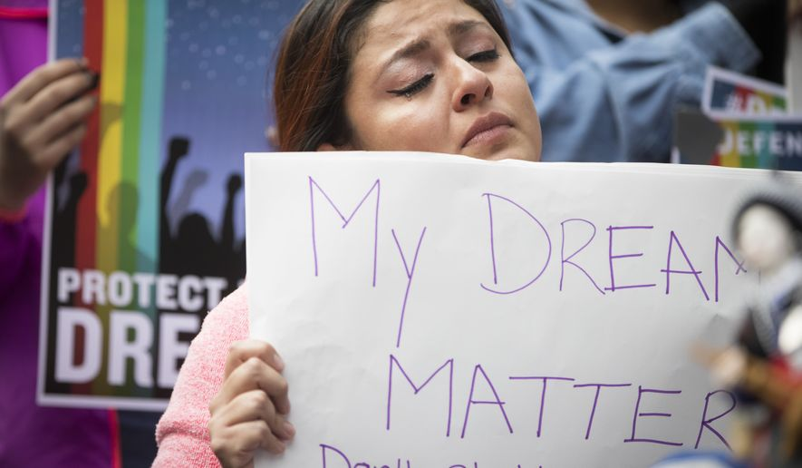 """Evelin Hernandez cries as she hold a sign reading """"My dreams matter. Don't shatter them."""" at a protest against the announcement that the Trump administration is ending the Deferred Action for Childhood Arrivals program, known as DACA, in Minneapolis, Tuesday, Sept. 5, 2017. Hernandez is a special education paraprofessional and a DREAM act recipient. (Renee Jones Schneider/Star Tribune via AP)"""