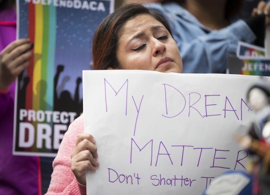 "Evelin Hernandez cries as she hold a sign reading ""My dreams matter. Don't shatter them."" at a protest against the announcement that the Trump administration is ending the Deferred Action for Childhood Arrivals program, known as DACA, in Minneapolis, Tuesday, Sept. 5, 2017. Hernandez is a special education paraprofessional and a DREAM act recipient. (Renee Jones Schneider/Star Tribune via AP)"