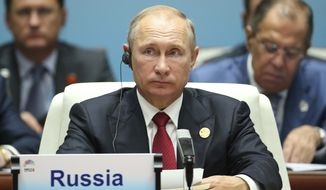 Russian President Vladimir Putin attends the Dialogue of Emerging Market and Developing Countries on the sideline of the BRICS Summit in Xiamen, China, Sept. 5, 2017. (Wu Hong/Pool Photo via AP)