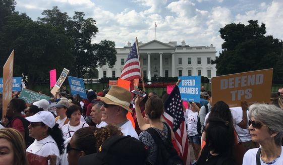 Supporters of the Deferred Action for Childhood Arrivals, or DACA, program gather outside the White House to protest President Trump. (The Washington Times/Laura Kelly)