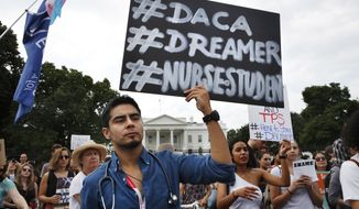 Carlos Esteban, 31, of Woodbridge, Va., a nursing student and recipient of Deferred Action for Childhood Arrivals, known as DACA, rallies with others in support of DACA outside of the White House, in Washington, Tuesday, Sept. 5, 2017. President Donald Trump will end a program that has protected hundreds of thousands of young immigrants brought into the country illegally as children and call for Congress to find a legislative solution.  (AP Photo/Jacquelyn Martin)