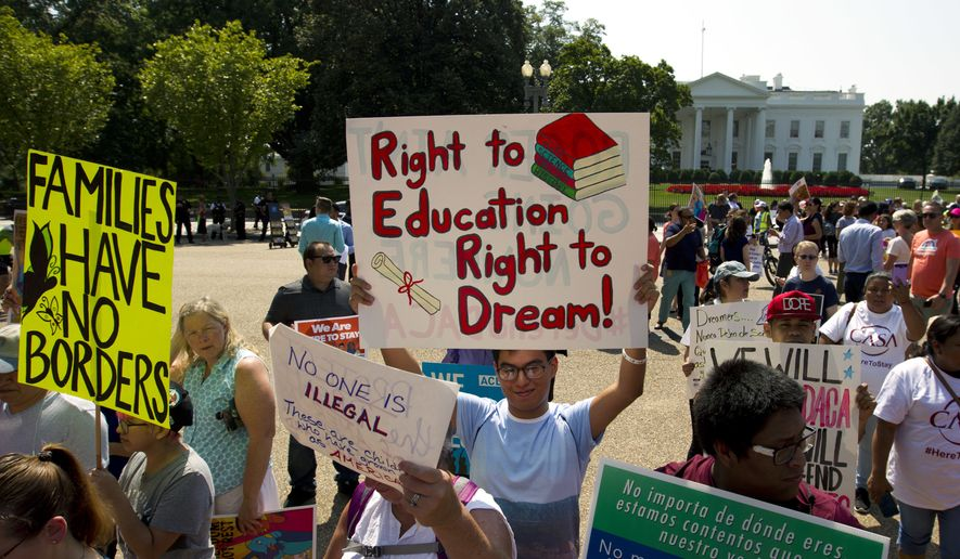 "Protesters hold up signs during a rally supporting Deferred Action for Childhood Arrivals, or DACA, outside the White House in Washington, on Tuesday, Sept. 5, 2017. President Donald Trump's administration will ""wind down"" a program protecting hundreds of thousands of young immigrants who were brought into the country illegally as children, Attorney General Jeff Sessions declared Tuesday, calling the Obama administration's program ""an unconstitutional exercise of authority."" ( AP Photo/Jose Luis Magana)"
