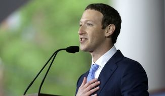 In this May 25, 2017, file photo, Facebook CEO Mark Zuckerberg delivers the commencement address at Harvard University commencement exercises in Cambridge, Mass. (AP Photo/Steven Senne, File)