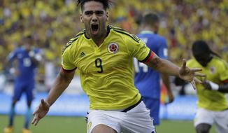 Colombia's Radamel Falcao celebrates after scoring a goal against Brazil during a 2018 World Cup qualifying soccer match in Barranquilla, Colombia, Tuesday, Sept. 5, 2017. The match ended in a 1-1 tie. (AP Photo/Ricardo Mazalan)