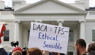 "A person holds up a sign in support of the Deferred Action for Childhood Arrivals, known as DACA, and Temporary Protected Status programs during a rally in support of DACA and TPS outside of the White House, in Washington, Tuesday, Sept. 5, 2017. President Donald Trump's administration will ""wind down"" a program protecting hundreds of thousands of young immigrants who were brought into the country illegally as children, Attorney General Jeff Sessions declared Tuesday, calling the Obama administration's program ""an unconstitutional exercise of authority.""  (AP Photo/Jacquelyn Martin)"