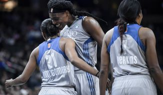 FILE - In this Aug. 3, 2017, file photo, Minnesota Lynx center Sylvia Fowles bumps chests with guard Renee Montgomery (21) during the fourth quarter of the team's WNBA basketball game against the Atlanta Dream, in St. Paul, Minn. Fowles had a stellar year to lead Minnesota to the top seed in the WNBA playoffs.  Her efforts earned her Associated Press WNBA Player of the Year honors on Tuesday, Sept. 5, 2017.  (Aaron Lavinsky/Star Tribune via AP, File)/Star Tribune via AP)