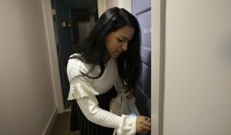 In this Wednesday, Aug. 30, 2017 photo, Ninotska Love, who has been accepted at Wellesley College, opens the door to her dorm room at the school in Wellesley, Mass. A growing number of women's colleges are welcoming transgender women on campus after refusing to admit them for years. Two trans women, including Ninotska, attending Wellesley this fall are believed to be the first at the school since it decided to start allowing trans women in 2015. (AP Photo/Steven Senne)