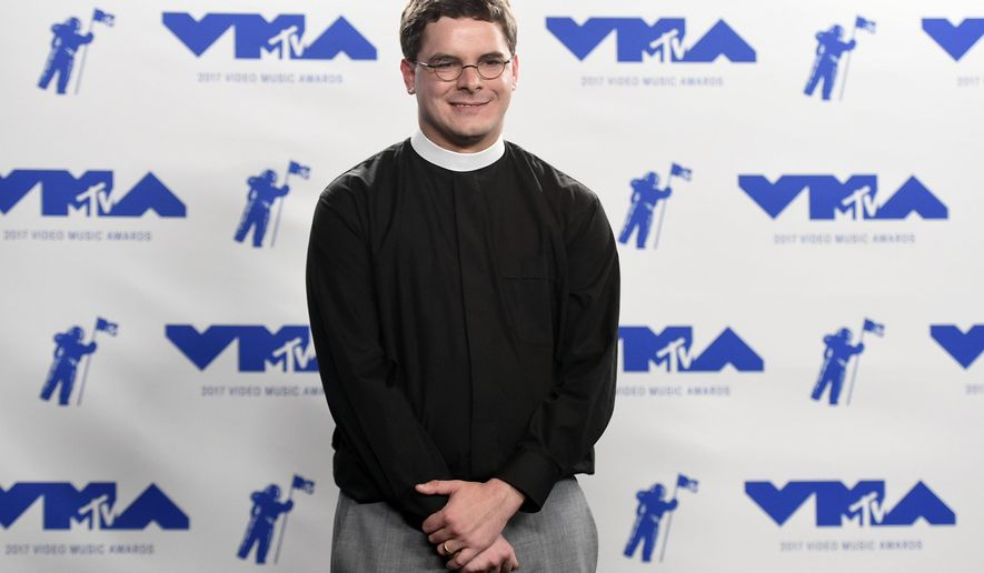 FILE- In this Sunday, Aug. 27, 2017, file photo, Rev. Robert Wright Lee, a descendant of Confederate Army General Robert E. Lee, poses in the press room at the MTV Video Music Awards at The Forum in Inglewood, Calif. Lee is stepping down as pastor of the Bethany United Church of Christ in Winston-Salem, N.C., after negative reactions to his comments supporting racial justice activists on an MTV broadcast. (Photo by Jordan Strauss/Invision/AP, File)