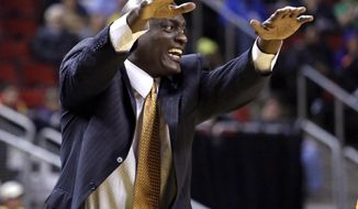 "FILE - In this June 13, 2017, file photo, Atlanta Dream head coach Michael Cooper motions about a call in favor of the Seattle Storm in the second half of a WNBA basketball game, in Seattle. The Atlanta Dream have fired coach Michael Cooper after their worst season since 2008. The WNBA team announced Tuesday, Sept. 5, 2017, that it ""decided to part ways"" with Cooper, the former Los Angeles Lakers star who guided the team for the last four years.(AP Photo/Elaine Thompson, File)"